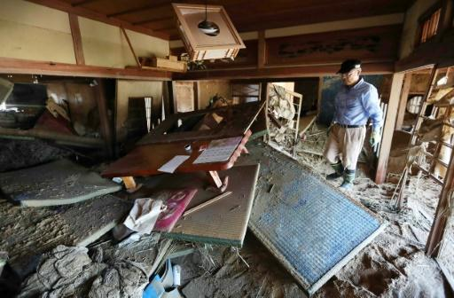 Record rainfall that unleashed devastating floods and landslides has killed at least 156 people in Japan, and many of those who survived face an uncertain future in homes and towns transformed beyond recognition