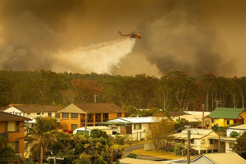 An Aircrane water bombing helicopter drops water on a bushfire in Harrington