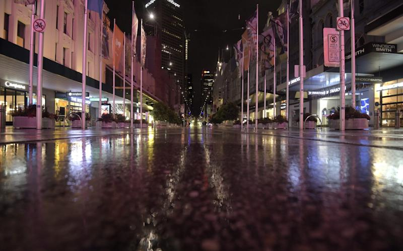 Bourke Street Mall in Melbourne stands deserted during an overnight curfew - Carla Gottgens/Bloomberg