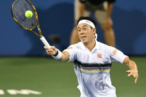Kei Nishikori of Japen returns a shot to Donald Young of the US on day five of the Citi Open, at the Rock Creek Tennis Center in Washington, DC, on August 1, 2018