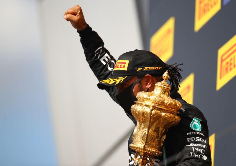 Hamilton credits survival instinct for three-wheeled win