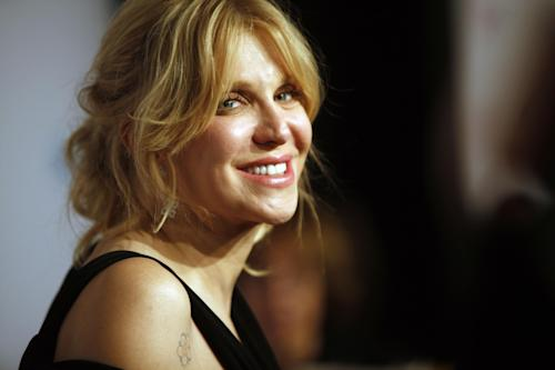 "FILE - In this Oct. 15, 2013 file photo, Courtney Love arrives at the Elton John AIDS Foundation's 12th Annual ""An Enduring Vision"" benefit gala at Cipriani Wall Street, in New York. A jury determined Friday, Jan. 24, 2014, that Love did not defame a San Diego attorney when she sent a 2010 tweet stating that the lawyer had been ""bought off."" Attorneys for Rhonda Holmes had been seeking $8 million in damages but the jury rejected her case. (Photo by Carlo Allegri/Invision/AP, file)"