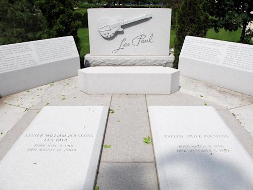 "This May 30, 2013 photo shows the grave site of Les Paul, the renown musician also known for his innovations on the solid body electric guitar and multitrack recording, buried next to his mother at Prairie Home Cemetery in Waukesha, Wis. The Waukesha County Museum is opening a permanent exhibit on June 9, about the Waukesha native called ""Les Paul: The Wizard of Waukesha."" (AP Photo/Carrie Antlfinger)"