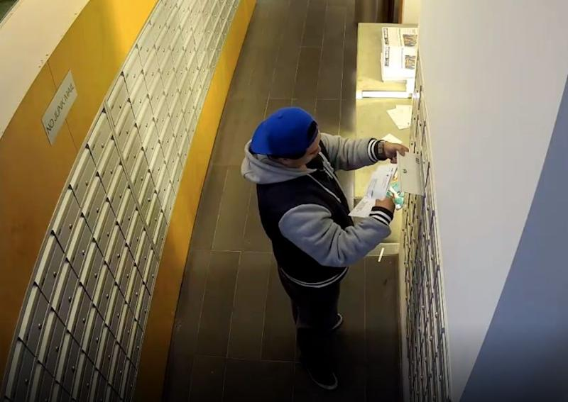 A man can be seen checking out mail inside the Southbank apartment complex in Melbourne.