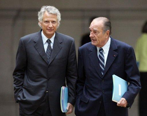 A picture taken in 2007 shows then French President Jacques Chirac (R) chatting with then PM Dominique de Villepin