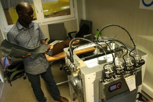 Technician Fabrice Agbelehounko Djodji checks the work of a 3D printer used to produce prosthetic supports at the African Organisation for the Development of Centres for Disabled People in Lome. Making 3D devices locally is expected to cut costs