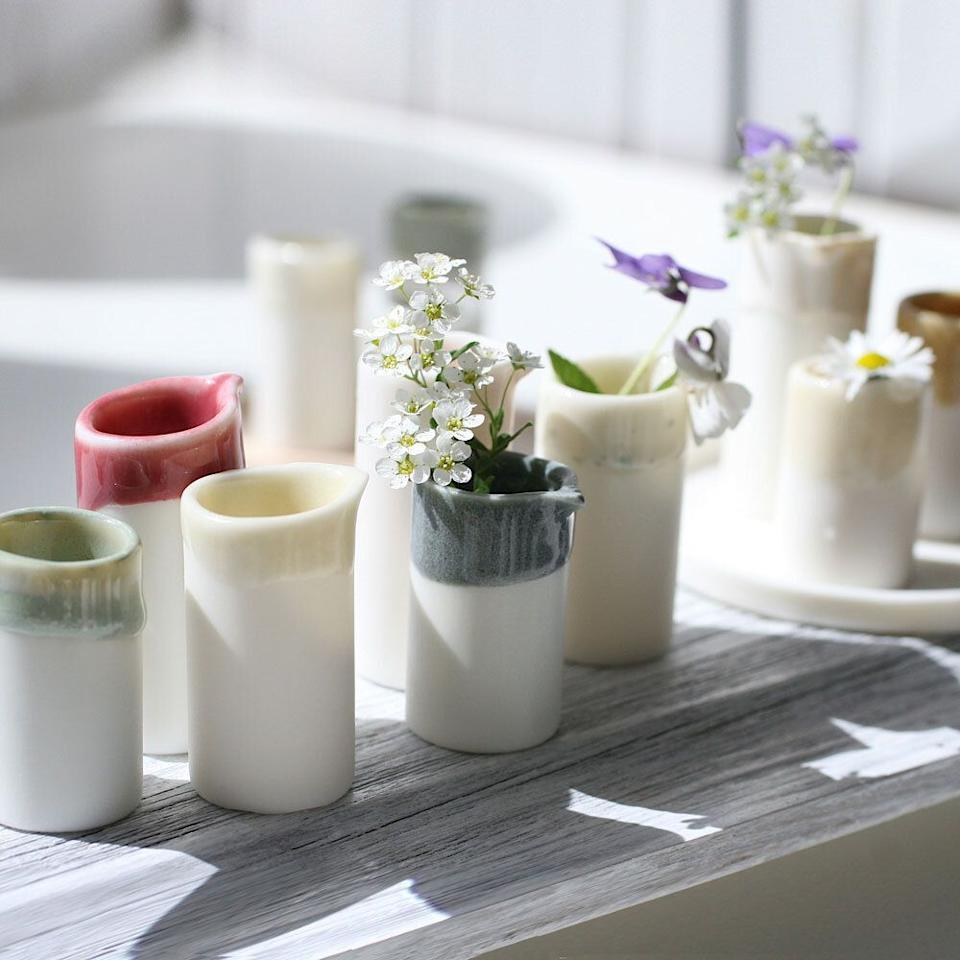 """<p><strong>Naked Clay Ceramics</strong></p><p>nakedclayceramics.com</p><p><strong>£12.00</strong></p><p><a href=""""https://www.nakedclayceramics.com/shop/whitewildflowerbudvase"""" target=""""_blank"""">Shop Now</a></p><p>These miniature bud vases by <a href=""""https://www.nakedclayceramics.com/about-naked-clay-ceramics"""" target=""""_blank"""">Naked Clay Ceramics's</a> Carla Sealey are just one of the plethora of adorably charming items in her Bedfordshire-based shop.</p>"""