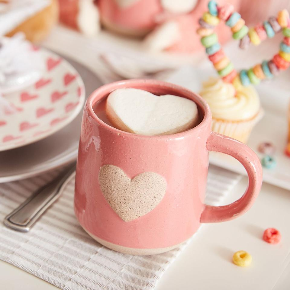 "<p>This <a rel=""nofollow"" href=""https://www.popsugar.com/buy/Heart%20Stoneware%20Mug-404384?p_name=Heart%20Stoneware%20Mug&retailer=pier1.com&price=7&evar1=moms%3Aus&evar9=45663736&evar98=https%3A%2F%2Fwww.popsugar.com%2Fmoms%2Fphoto-gallery%2F45663736%2Fimage%2F45663928%2FHeart-Stoneware-Mug&list1=shopping%2Cvalentines%20day%2Cdecor%20shopping%2Cpier%201%20imports&prop13=mobile&pdata=1"" rel=""nofollow"">Heart Stoneware Mug</a> ($7) makes drinks so much sweeter.</p>"