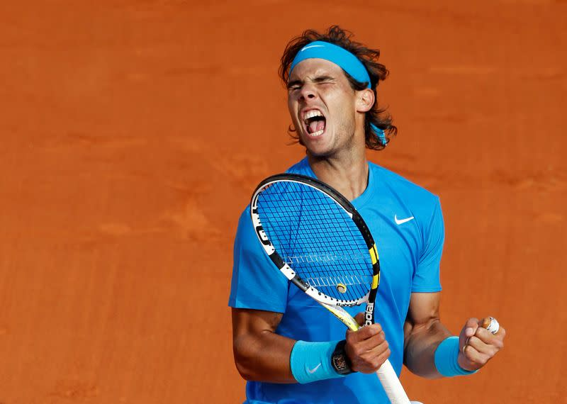 FILE PHOTO: Spain's Rafa Nadal celebrates victory against American John Isner in the French Open first round at Roland Garros in Paris.