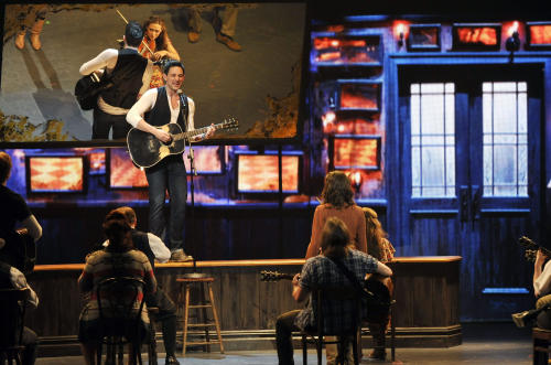 "Steve Kazee performs in a scene from ""Once"" at the 66th Annual Tony Awards on Sunday June 10, 2012, in New York. (Photo by Charles Sykes /Invision/AP)"