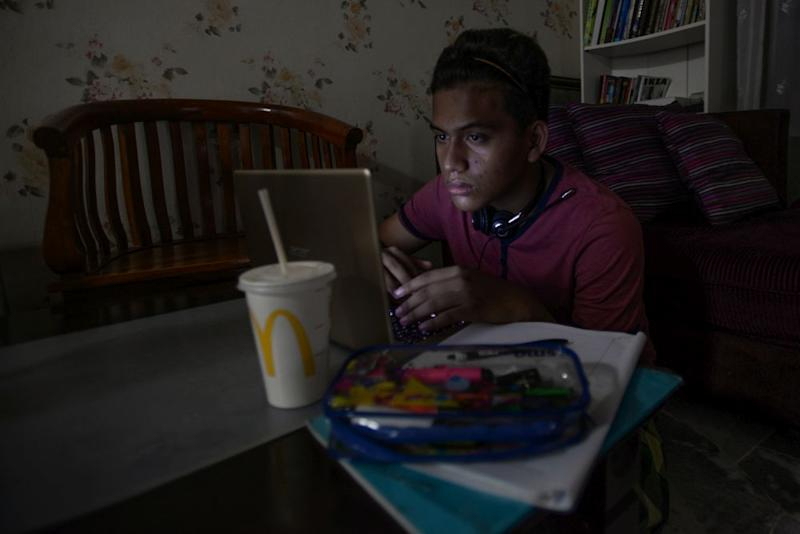 A student takes online lessons during phase three of the movement control order in Shah Alam April 15, 2020. — Picture by Miera Zulyana