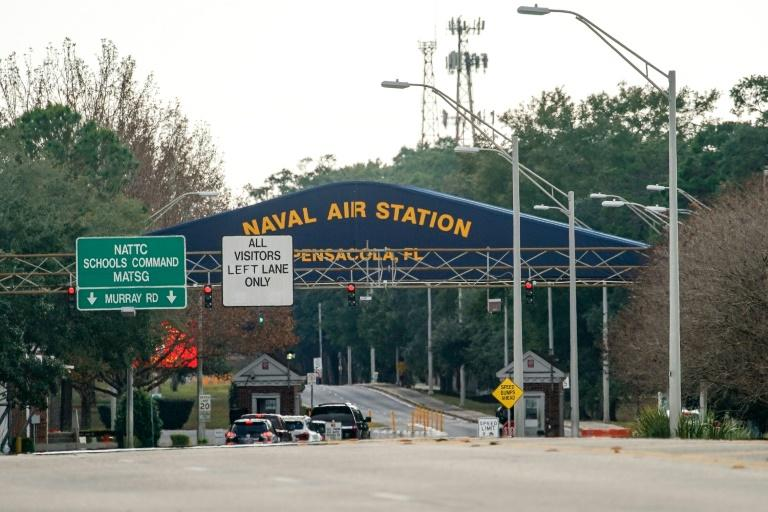 """The Pensacola, Florida Naval Air Station where a Saudi air force student shot dead three US sailors on December 6, 2019 in what the Justice Department said was an """"act of terrorism."""" main gate following a shooting on December 06, 2019 in Pensacola, Florida. The second shooting on a U.S. Naval Base in a week has left three dead plus the suspect and seven people wounded. Josh Brasted/Getty Images/AFPPENSACOLA, FLORIDA - DECEMBER 06: A general view of the atmosphere at the Pensacola Naval Air Station main gate following a shooting on December 06, 2019 in Pensacola, Florida. The second shooting on a U.S. Naval Base in a week has left three dead plus the suspect and seven people wounded. Josh Brasted/Getty Images/AFP"""