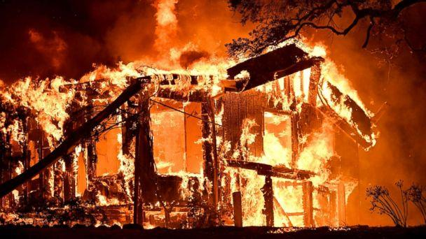 PHOTO: Flames ravage a home in the Napa wine region in California, Oct. 9, 2017, as multiple wind-driven fires continue to whip through the region. (AFP/Getty Images)