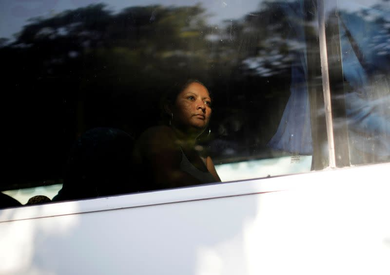 FILE PHOTO: A migrant is seen in a bus near Frontera Hidalgo