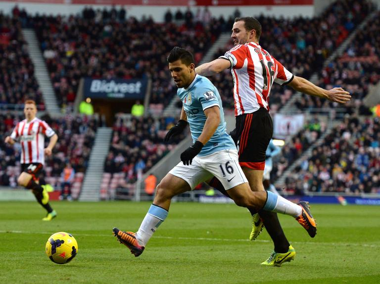 Manchester City's Aguero is challenged by Sunderland's O'Shea during their English Premier League soccer match in Sunderland