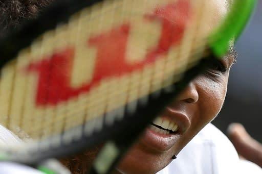 Serena Williams returns against Camila Giorgi during their quarter-final at the All England Club