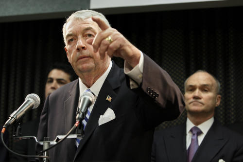 FILE- In this Oct. 18, 2006 file photo, Brooklyn District Attorney Charles Hynes gestures during a press conference announcing new indictments involving funeral homes who were illegally removing bones and tissue from the deceased and selling it for transplants. A CBS documentary series featuring Hynes airs Tuesday, June 18, 2013, and gives viewers a look at how cases are prosecuted at one of the largest district attorney offices in the country. Hynes is running for office and his opponents say the timing of the show is unfair. (AP Photo/Adam Rountree, File)