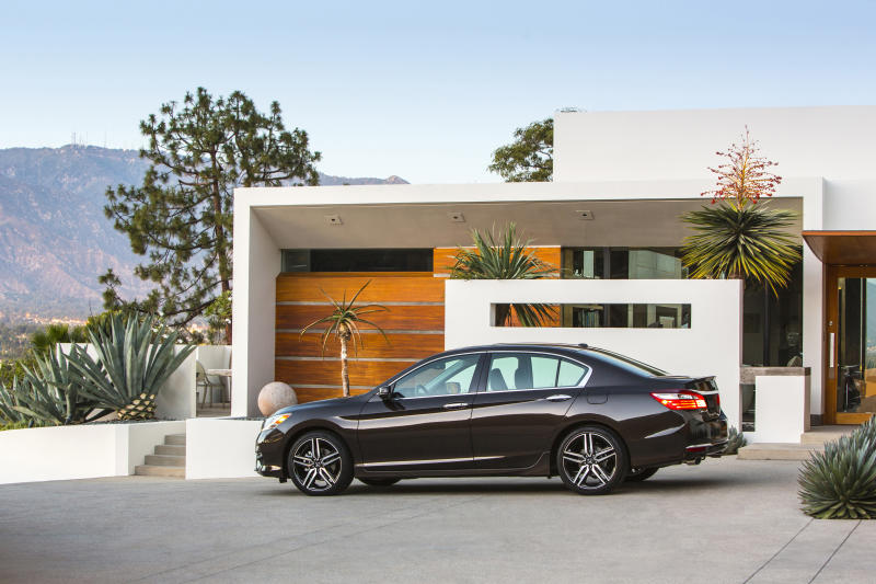 This photo provided by Honda shows the 2016 Honda Accord sedan, which is well-known for its sporty handling and long list of standard features, including a rearview camera. (Courtesy of American Honda Motor Co. via AP)