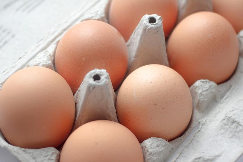 This picture shows six large eggs sitting in a carton.