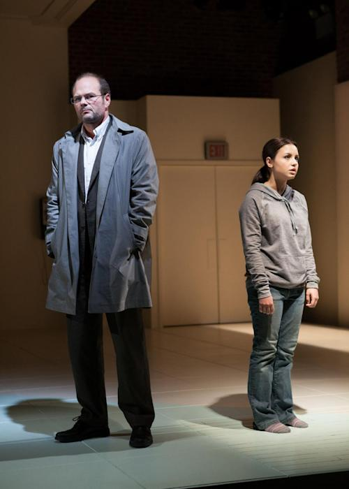 "This publicity photo released by Boneau/Bryan-Brown shows Chris Bauer, left, and Aimee Carrero in a scene from ""What Rhymes With America,"" a new play by Melissa James Gibson premiering off-Broadway at the Atlantic Theater Company. (AP Photo/Boneau/Bryan-Brown, Kevin Thomas Garcia)"
