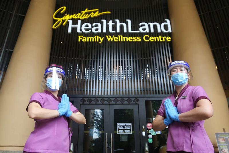 Therapists decked in protectice gear are pictured at the Healthland Wellness Centre in Sunway Pyramid June 30, 2020. — Picture by Choo Choy May