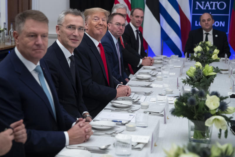 President Donald Trump smiles during a working lunch with NATO members that have met their financial commitments to the the organization, at The Grove, Wednesday, Dec. 4, 2019, in Watford, England. (AP Photo/ Evan Vucci)