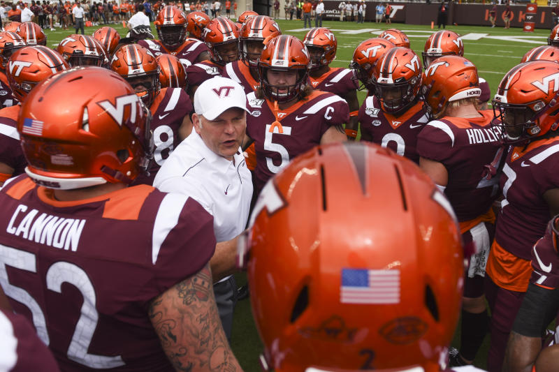 Justin Fuente of the Virginia Tech Hokies speaks to his team inside a huddle prior to the game against the Furman Paladins at Lane Stadium on September 14, 2019 in Blacksburg, Virginia. (Getty)