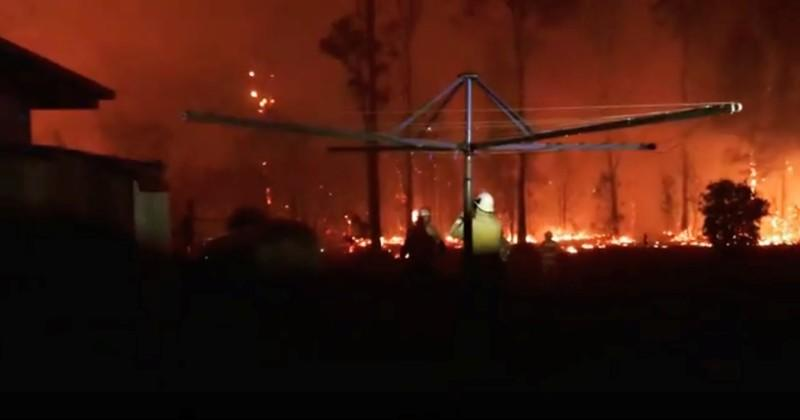 Firefighters look as a fire rages on in Rainbow Flat, New South Wales, Australia