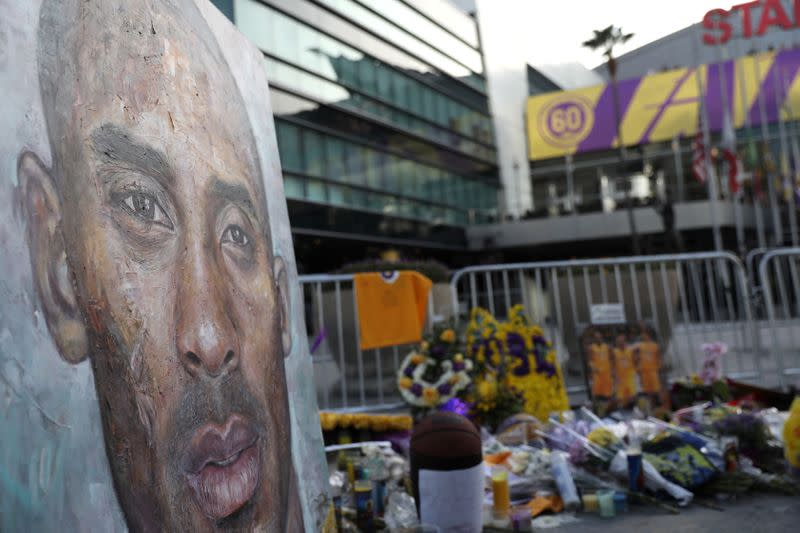 Floral and gift tributes lie outside Staples Center before a Los Angeles Lakers home game