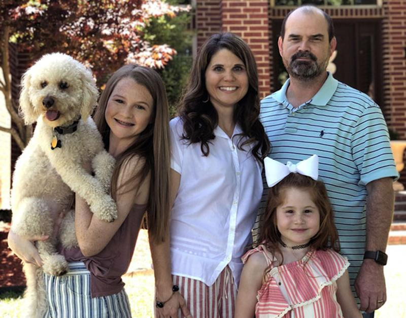 (From left) Dog Charlie with his family, Marcie, Jenee, Paige, and Jamie Clayton. Source: Caters