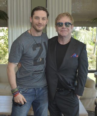 Call the Fashion Police: Tom Hardy Has Been Wearing Elton John's Clothes