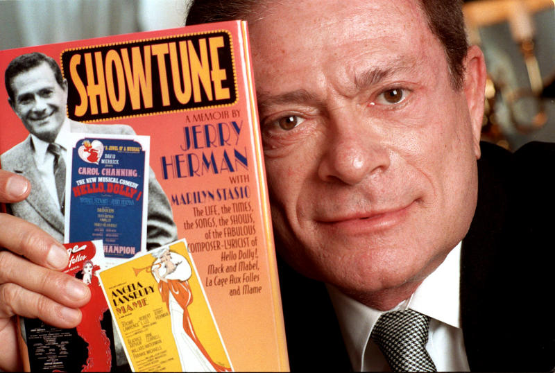 "FILE - In this Nov. 19, 1996, file photo, composer Jerry Herman displays his book ""Showtune,"" in New York. Herman, the Tony Award-winning composer behind ""Hello, Dolly!"" and ""La Cage aux Folles,"" has died at age 88. (AP Photo/Jim Cooper, File)"