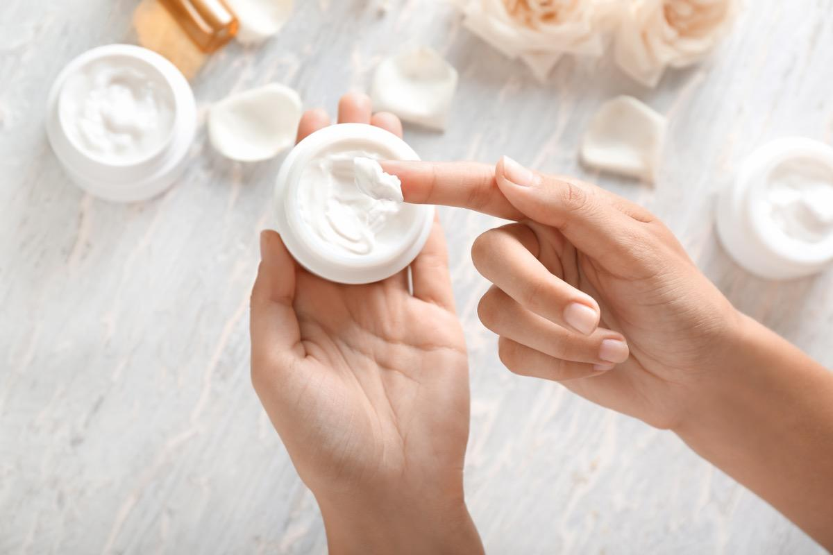 """Emollients—moisturizers that smooth and soften the skin—are your winter skin's biggest ally. """"Your skincare products should be more emollient in the winter and lighter in the summer in order to compensate for the <a href=""""https://bestlifeonline.com/how-winter-affects-your-sleep/?utm_source=yahoo-news&utm_medium=feed&utm_campaign=yahoo-feed"""" target=""""_blank"""">effects of seasonal weather changes</a>,"""" says <strong>Elina Fedotova</strong>, celebrity esthetician and owner of <a href=""""https://elinaorganics.com/"""" target=""""_blank"""">Elina Organics Spas and Skincare</a>. """"In the Northern states where winter can be harsh, our skin is at a higher risk of becoming over-dried from intense winds outside and dry heat indoors. The blood vessels in your face and hands also become fragile from drastic temperature changes."""" Some of her favorite moisturizing ingredients include shea butter, castor oil, and avocado oil."""