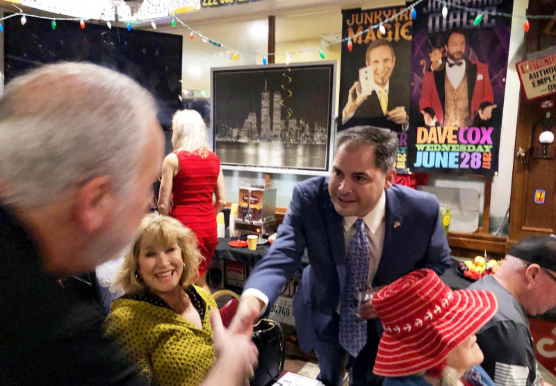 In this Tuesday, Jan. 28, 2020 photo, 25th District congressional candidate and former Navy combat pilot Mike Garcia greets supporters in Simi Valley, Calif. (AP Photo/Michael Blood)