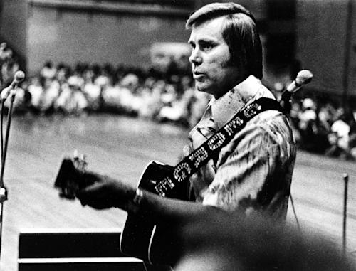 "FILE - In this undated photo, Country singer George Jones is shown performing with his guitar. Jones, the peerless, hard-living country singer who recorded dozens of hits about good times and regrets and peaked with the heartbreaking classic ""He Stopped Loving Her Today,"" has died. He was 81. Jones died Friday, April 26, 2013 at Vanderbilt University Medical Center in Nashville after being hospitalized with fever and irregular blood pressure, according to his publicist Kirt Webster. (AP Photo, File)"