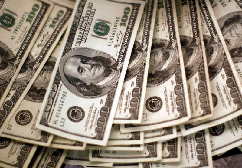 Dollar gains after weeks of losses as investors focus on U.S. aid package