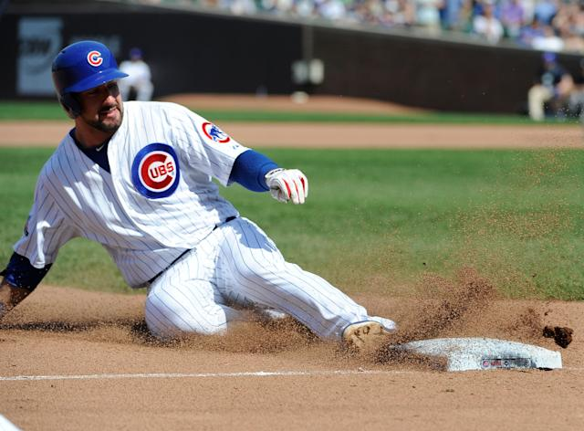 CHICAGO, IL - MAY 21: Ryan Kalish #51 of the Chicago Cubs slides safely into third base with a triple against the New York Yankees during the seventh inning on May 21, 2014 at Wrigley Field in Chicago, Illinois. (Photo by David Banks/Getty Images)