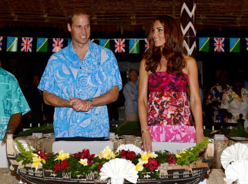 Britain's Prince William, left, and his wife Kate prepare to sit for a meal at Government House in Honiara, Solomon Islands, Sunday, Sept. 16, 2012. The royal couple is on a nine-day tour of the Far East and South Pacific in celebration of Queen Elizabeth II's Diamond Jubilee. (AP Photo/William West, Pool)