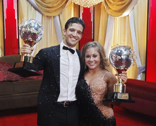 "In this May, 19, 2009 file photo released by ABC, Shawn Johnson and her professional partner, Mark Ballas, hold their trophies during Dancing with the Stars finale show in Los Angeles. ABC says an ""All-Star"" edition of the competition show will bring back 12 former rivals including Pamela Anderson, Kristie Alley, Bristol Palin and previous winner Johnson. In a break from the past, viewers can vote online for the 13th contestant from three former contestants including actors Kyle Massey and Sabrina Bryan and celebrity stylist Carson Kressley. The celebrity dance competition series returns on ABC on Sept. 24. (AP Photo/ABC, Kelsey McNeal)"