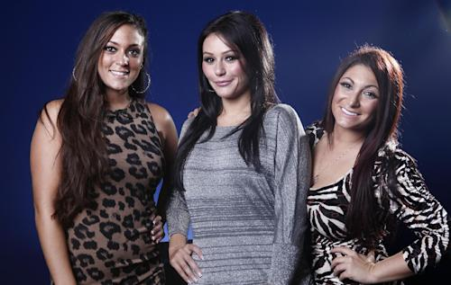 """This Oct. 3, 2012 photo shows cast members from """"Jersey Shore,"""" from left, Sammi """"Sweetheart"""" Giancola, Jenni """"JWOW"""" Farley, and Deena Cortese pose for a portrait in New York. The final season of the MTV reality season premieres on Thursday. (Photo by Carlo Allegri/Invision/AP)"""