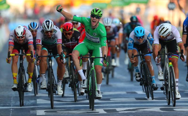 Sam Bennett celebrates winning the final stage in Paris in the green jersey
