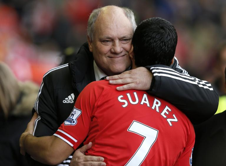 Fulham manager Jol embraces Liverpool player Suarez before their English Premier League soccer match at Anfield in Liverpool