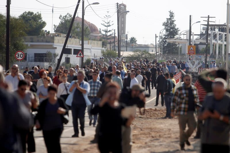 FILE PHOTO: People cross at newly opened checkpoint in Dherinia