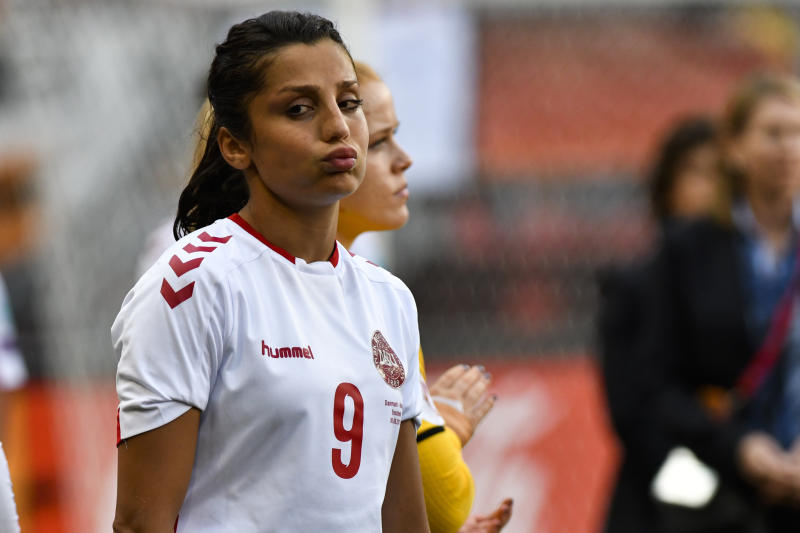 FILE - In this file photo dated Sunday, Aug. 6, 2017, Denmark's Nadia Nadim during the Women's Euro 2017 final soccer match against  Netherlands in Enschede, the Netherlands. Two decades after fleeing Afghanistan, the Paris Saint-Germain and Denmark striker Nadia Nadim is ready to go home, she tells The Associated Press Wednesday Dec. 4, 2019, that she will take a chance with her safety because the risks are worth it to inspire girls to follow her onto the soccer field. (AP Photo/Patrick Post, FILE)