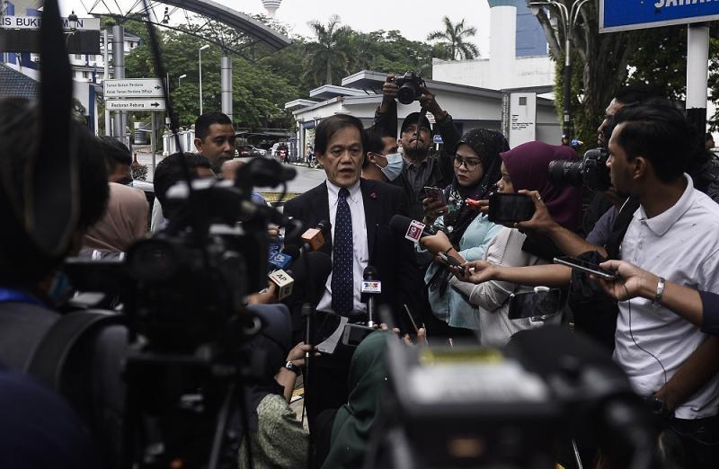 Al Jazeera lawyer Hisyam Teh Poh Teik speaks to reporters outside the Bukit Aman headquarters in Kuala Lumpur July 10, 2020. ― Picture by Miera Zulyana