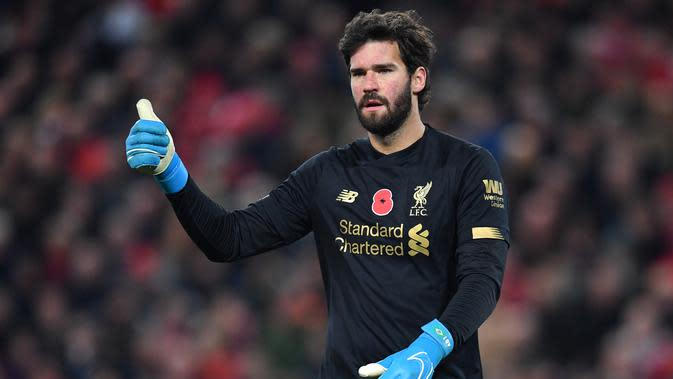 7. Alisson Becker - Liverpool : 67 Voting. (AFP/Paul Ellis)