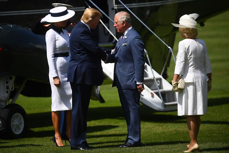 US President Donald Trump and First Lady Melania Trump are greeted by Prince Charles and Camilla, Duchess of Cornwall