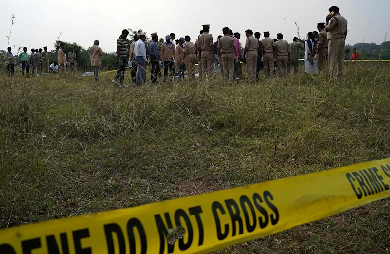 Forensic officials examine the bodies at the site where police shot dead four men suspected of raping and killing a 27-year-old veterinarian, in Chatanpally on the outskirts of Shadnagar town, Telangana, on December 6, 2019. (Photo by REUTERS/Swarat Ghosh)