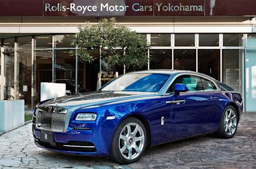 This July 2013 publicity photo provided by courtesy of Rolls-Royce Motor Cars Ltd. shows the Rolls-Royce Wraith making its public debut at Yokohama Concours D'Elegance in Yokohama, Japan. It's the most powerful Rolls ever built, with a 6.6-liter V12 engine that gets 624 horsepower. Inside, there's a new system that uses GPS data and navigation to scan the road ahead and automatically pick out the right gear from the eight-speed transmission. (AP Photo/Copyright Rolls-Royce Motor Cars Ltd.)