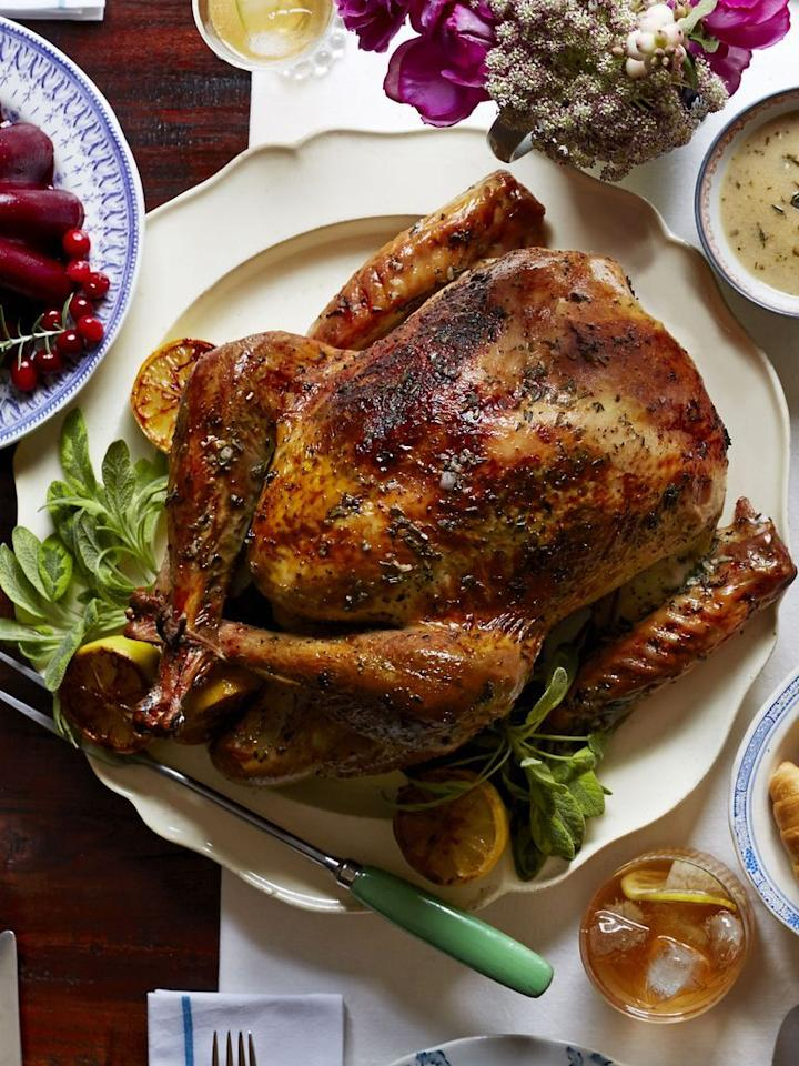 """<p>A traditional British Christmas dinner looks similar to an American Thanksgiving dinner (they don't celebrate, after all!). While the list below has British-themed dishes, such as pigs in blankets and fruitcake in the form of cookies, the way to truly make it feel authentic is to whip up a batch of Yorkshire pudding and break open some Christmas crackers.</p><p><strong>Appetizers:</strong></p><p><a href=""""https://www.countryliving.com/food-drinks/recipes/a3263/pigs-in-blanket-recipe/"""">Pigs in Blankets</a></p><p><strong>Main Course:</strong></p><p><a href=""""https://www.countryliving.com/food-drinks/recipes/a5944/herb-citrus-butter-roasted-turkey-recipe-clx1114/"""">Herb and Citrus Butter Roasted Turkey</a></p><p><a href=""""https://www.countryliving.com/food-drinks/recipes/a5934/thyme-pear-gravy-recipe-clx1114/"""">Thyme-Pear Gravy</a></p><p><strong>Side Dishes:</strong></p><p><a href=""""https://www.countryliving.com/food-drinks/recipes/a4061/roasted-potatoes-fresh-herbs-recipe-clx0312/"""">Roasted Potatoes with Fresh Herbs</a></p><p><a href=""""https://www.countryliving.com/food-drinks/recipes/a40026/rosemary-monkey-bread-stuffing-recipe/"""">Rosemary Monkey Bread Stuffing</a></p><p><a href=""""https://www.countryliving.com/food-drinks/recipes/a45288/roasted-brussels-sprouts-recipe/"""">Roasted Brussels Sprouts</a></p><p><a href=""""https://www.countryliving.com/food-drinks/recipes/a4235/spiced-cranberry-sauce-orange-star-anise-recipe-clv1112/"""">Spiced Cranberry Sauce with Orange and Star Anise</a></p><p><strong>Dessert:</strong></p><p><a href=""""https://www.countryliving.com/food-drinks/a29643401/fruit-and-nut-trifle-recipe/"""">Fruitcake Cookies</a></p><p><a href=""""https://www.countryliving.com/food-drinks/a29643401/fruit-and-nut-trifle-recipe/"""">Fruit and Nut Trifle</a></p><p><strong>Drink:</strong></p><p><a href=""""https://www.countryliving.com/food-drinks/a29639548/cranberry-gin-fizz-recipe/"""">Cranberry Gin Fizz</a></p><p><a class=""""body-btn-link"""" href=""""https://go.redirectingat.com?id=74968X1596630&u"""
